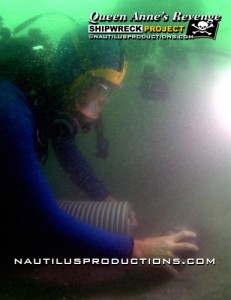 Rick Allen of Nautilus Productions videotapes underwater archaeologist Richard Lawrence uncovering a cannon ball from Blackbeard the Pirate's flagship, the Queen Anne's Revenge.